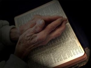 praying-hands-on-bible_19-107474