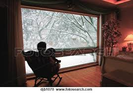 man sitting looking out window