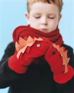boy wearing mittens and scarf